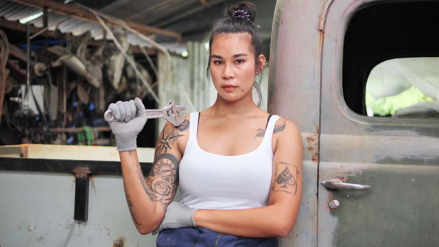 the auto mechanic and car spray is a woman with tattoos on the body, car, technician, mechanic, examining, owner, below, small business. - tattoo stock videos & royalty-free footage