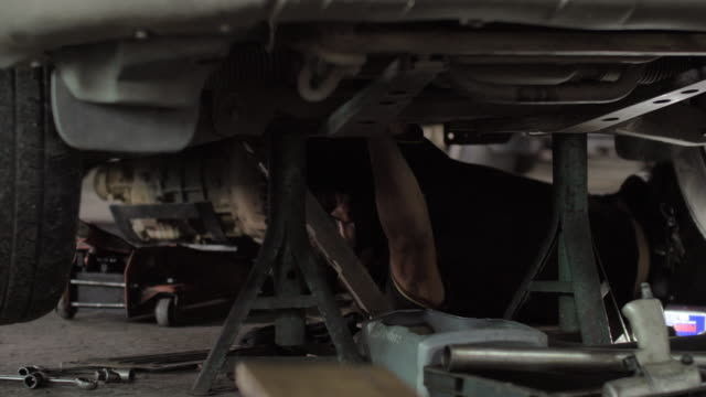 the auto mechanic is checking the oil change car. - mechanic stock videos & royalty-free footage