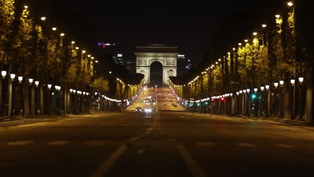 the avenue des champs-elysees, which is usually full of cars, is almost deserted at curfew time on october 18, 2020 in paris, france. france. the... - triumphal arch stock videos & royalty-free footage
