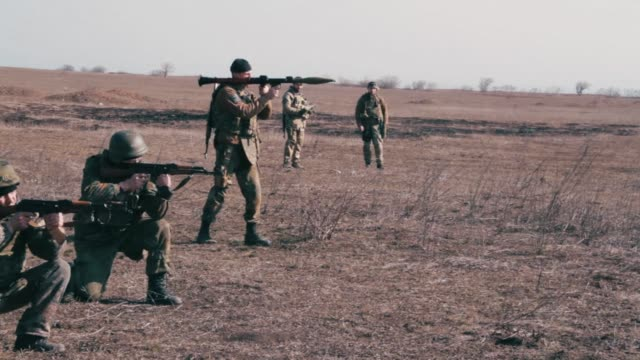 the azov battalion a paramilitary unit formed of ukrainian volunteers integrated into the ukrainian national guard trains near donetsk and stand... - battalion stock videos & royalty-free footage