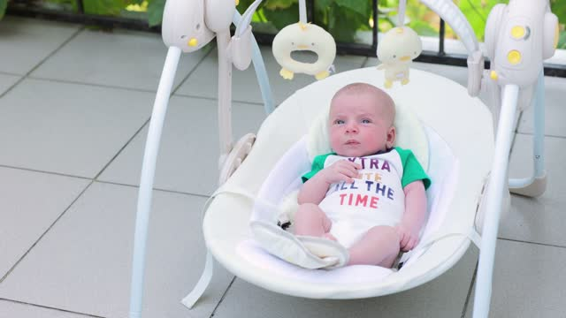 the baby lies in a baby rocking chair. - one baby boy only stock videos & royalty-free footage