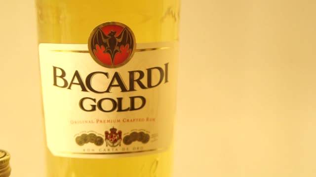 the bacardi building and various bacardi bottles in miami florida on january 27th 2015 shots exterior wide shot of the top of the bacardi building... - rum stock videos and b-roll footage