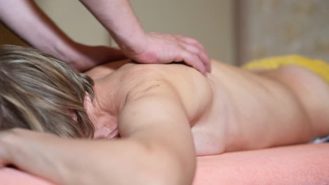 the back massage session for the senior 55 years old woman - 55 59 years stock videos & royalty-free footage