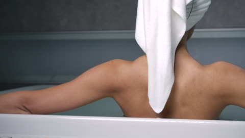 4k the back of a long haired black woman, she is tired from working hard. she soaked in the bathtub and rested her eyes. - resting stock videos & royalty-free footage