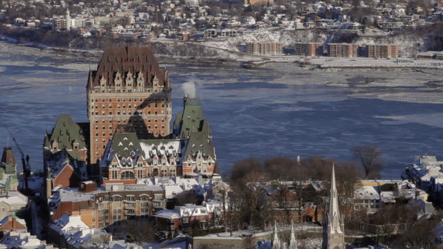 The back of the Chateau Frontenac with a view of the St. Lawrence River and Levis