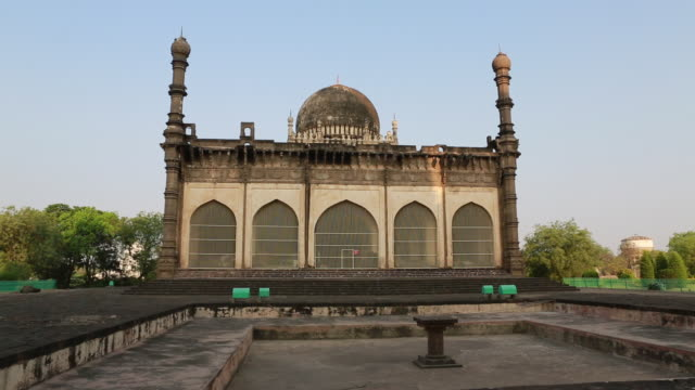 ws of the backside of the gol gumbaz the mausoleum of king mohammed adil shah sultan of bijapur on march 29 2013 in bijapur india bijapur city is... - mausoleum stock videos and b-roll footage