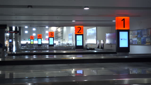 the baggage claim area at the airport in cabo san lucas, mexico. - cabo san lucas stock videos & royalty-free footage