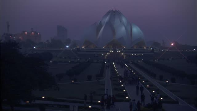 the baha'i house of worship rises above a delhi, india neighborhood. - delhi stock videos & royalty-free footage