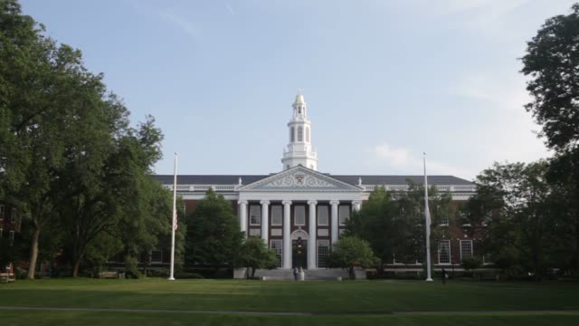 the baker library of the harvard business school on the harvard university campus in cambridge, ma, tuesday june 30, 2015. shots: a bell sits in... - harvard university stock videos & royalty-free footage