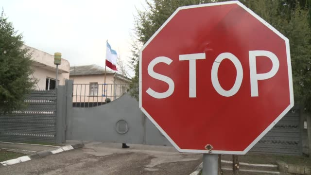 the bakhchisaray military base in crimean was proudly showing a russian flag thursday whilst the belbek military base in sevastapol remains under... - military base stock videos & royalty-free footage