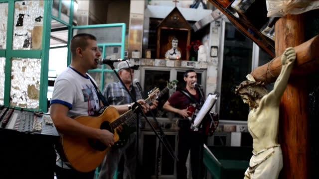 the band los indicados de la sierra perform a song praising the exploits of drug lord joaquin el chapo guzman after his second jailbreak - prison break stock videos & royalty-free footage