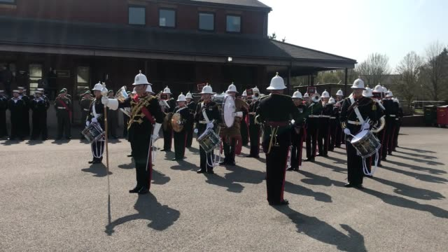 the band of her majesty's royal marines perform during a 40 commando royal marines parade, to celebrate their humanitarian efforts and reaction to... - 英国海兵隊点の映像素材/bロール