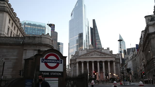 the bank of england and financial district skyscrapers with subway station entrance in foreground in london, u.k., on thursday, dec. 17, 2020. bank... - underground station stock videos & royalty-free footage