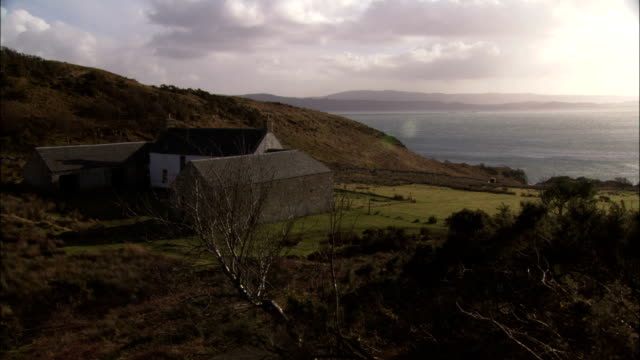 the barnhill house occupies a grassy plain near the seaside on the isle of jura, scotland. - hebrides stock videos & royalty-free footage