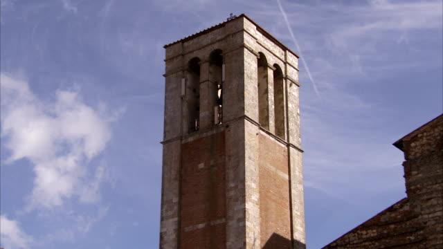 the baroque bell tower of the church of santa maria delle grazie contrasts against a blue sky. available in hd. - baroque点の映像素材/bロール