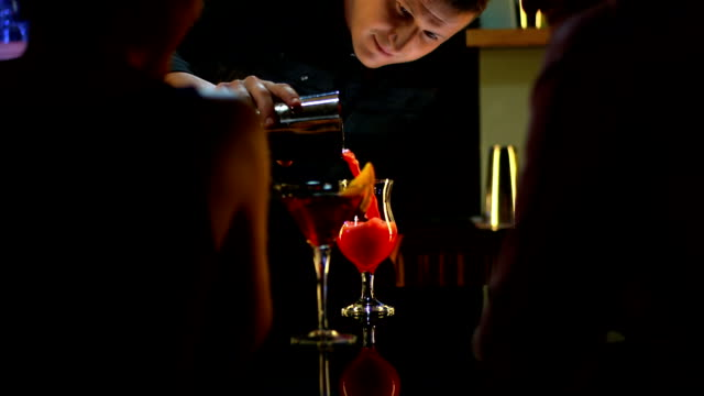 hd: the bartender making cocktails - bartender stock videos and b-roll footage