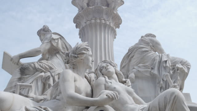 the base of the pallas athene statue outside the austrian parliament showing two representations of the rivers of the austro-hungarian empire, vienna. - lying down stock videos & royalty-free footage