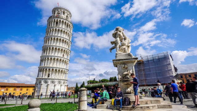 4K TIME-LAPSE PISA, ITALY - CIRCA MARCH 2015: The basilica, baptistery and the Leaning Tower of Pisa, Tourists are walking on the street in day light
