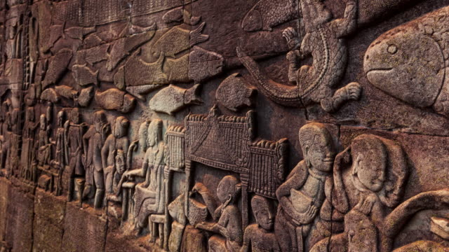 the bas-reliefs. bayon temple. angkor. - レリーフ点の映像素材/bロール