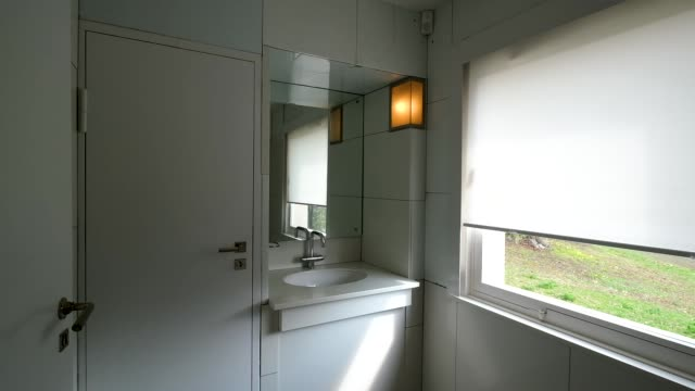 the bathroom of the haus am horn an original bauhaus family house from 1923 is seen during a press preview of the the new bauhausmuseum weimar on... - weimar video stock e b–roll