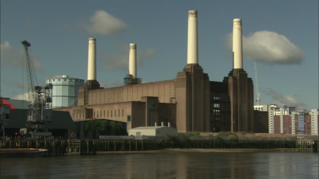 the battersea power plant occupies a riverbank in london. - battersea stock videos & royalty-free footage