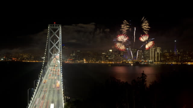 The Bay Bridge and the Super Bowl fireworks show over the skyscrapers of San Francisco