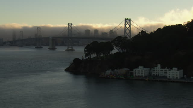 The Bay Bridge spans the San Francisco Bay.