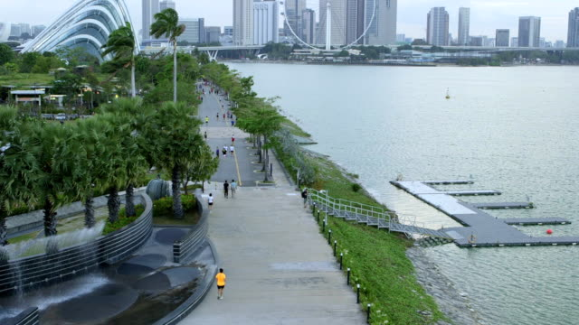 the bay near marina barrage park and downtown singapore - marina bay singapore stock videos and b-roll footage