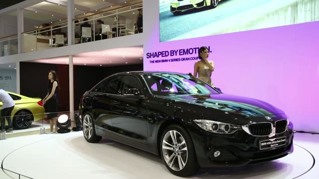 stockvideo's en b-roll-footage met the bayerische motoren werke ag 420d xdrive gran coupe vehicle sits on display during the press day of the 2014 busan international motor show in... - hybride voertuig