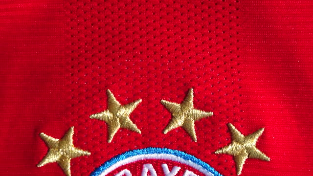 the bayern munchen home shirt displaying the club badge on june 08, 2021 in manchester, united kingdom. - shirt stock videos & royalty-free footage