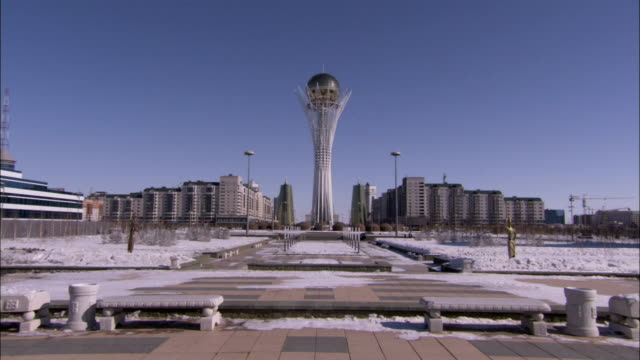 the bayterek monument towers above the city buildings in astana kazakhstan. available in hd. - kazakhstan stock videos & royalty-free footage