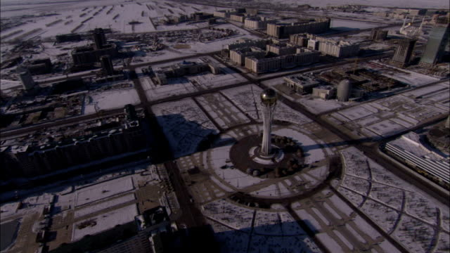 The Bayterek monument towers over a plaza in Astana Kazakhstan. Available in HD.