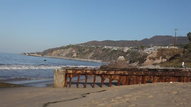 The beach of Malibu with a rusty footbridge in Los Angeles California USA