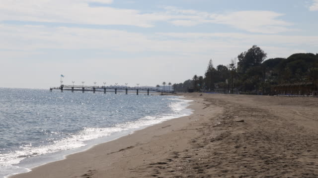 The beach of Marbella with its famous bridge which is located next to the Marbella Club Hotel