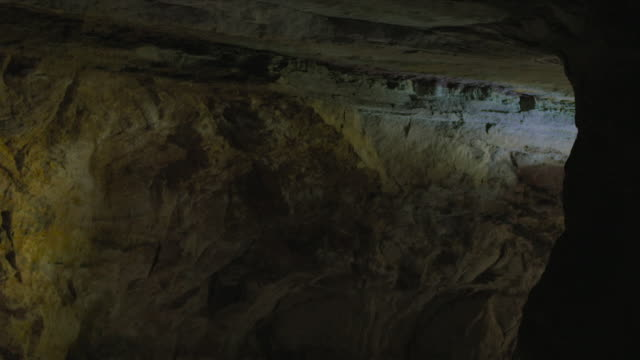 the beams of a torch in an old mine, uk - claustrophobia stock videos & royalty-free footage