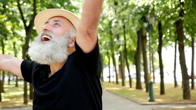 the bearded senior man is happy whirling - straw hat stock videos and b-roll footage