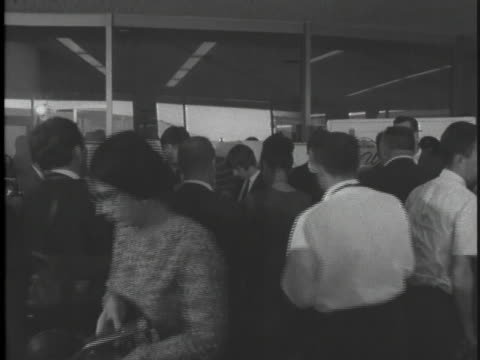 the beatles and their manager are photographed by reporters after their return to los angeles in 1964. - music stock videos & royalty-free footage