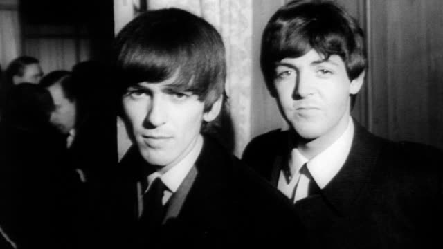 vídeos de stock, filmes e b-roll de the beatles attend luncheon at the british variety club and receive award for the top show business personality of 1963 / ringo starr john lennon... - 1964
