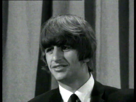 the beatles drummer ringo starr is interviewed about his operation and being a beatle / ringo departs on plane with brian epstein interview with... - ringo starr stock videos and b-roll footage