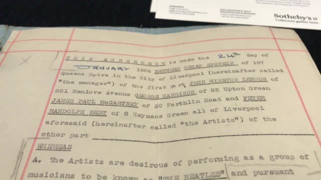the beatles' first contract with manager brian epstein marking the start of their transformation into worldconquering pop band will be offered for... - sotheby's stock videos and b-roll footage