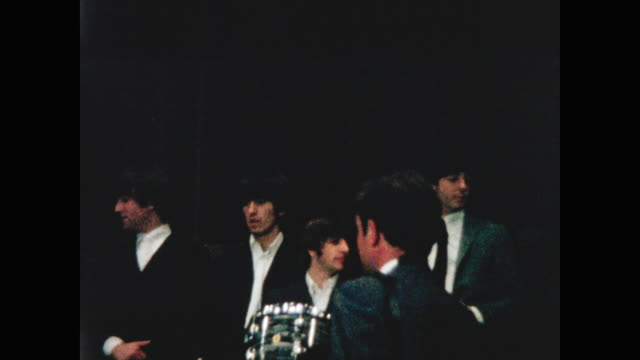 The Beatles give a press conference on the stage of the Forum Theatre Montreal