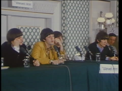 the beatles give an interview in 1966 about the american press taking statements out of context. - rock group stock videos & royalty-free footage