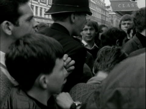 "the beatles give away apple shop goods; england : london : baker streer ms sign: ""apple"": bv mob outside: hatfield: sof: situationer: ""the beatles... - the beatles stock videos & royalty-free footage"