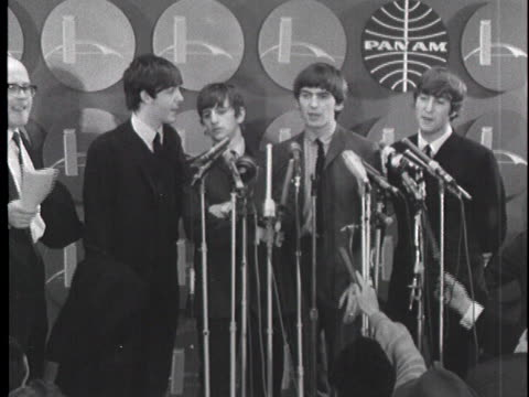 the beatles hold a press conference and joke with reporters about their success at jfk airport on february 7, 1964. - the beatles bildbanksvideor och videomaterial från bakom kulisserna