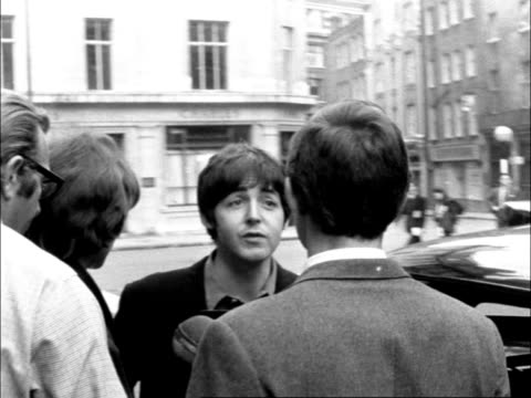 "the beatles in london before start of american tour; england, london:extms the beatles out of hotel and along to carms paul mccartney out: sof: ""a... - popular music tour stock videos & royalty-free footage"