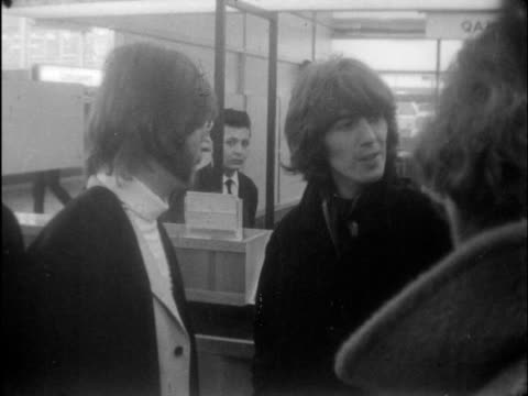 john lennon and george harrison leave for india:; england: london: lap : int john lennon with sideburns and specs george harrison: pan to his wife,... - sideburn stock videos & royalty-free footage