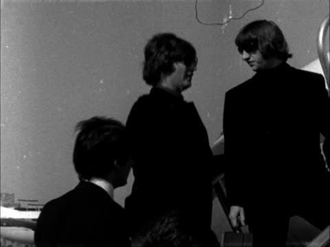 the beatles leave for france:; england: london: lap : ext cms paul mccartney looks at card and pose in box by car cms ringo starr walks l-r cms paul... - paul mccartney stock videos & royalty-free footage