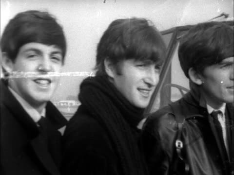 the beatles leave for sweden; england: london: lap: pan the four beatles group poses on steps and wave neg 16mm brenards 13 secs 8.5 ft 23.10.63 /... - the beatles stock videos & royalty-free footage