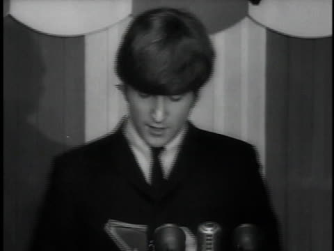 the beatles receiving british variety award at luncheon lennon thanks crowd for purple heart crowd laughing / london united kingdom united kingdom - paul mccartney stock videos and b-roll footage