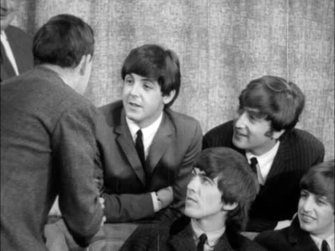 the beatles return from america; england: london: lap : int 1 shot and interview with the beatles sof: - paul mccartney stock videos & royalty-free footage